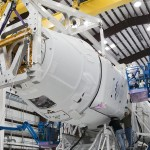 Dragon capsule lifted for inspection
