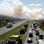 Trucks carrying a swarm of Thermite robotic firefighters to the scene