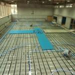 Glass floor construction using aluminum substructure