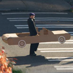 Man in carboard car
