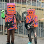 Two box-guitarists