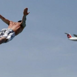Well-timed photo gives man the allusion of flying with an airplane