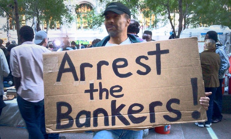 Protestor during the 2008 financial crisis (Arrest the Bankers sign)