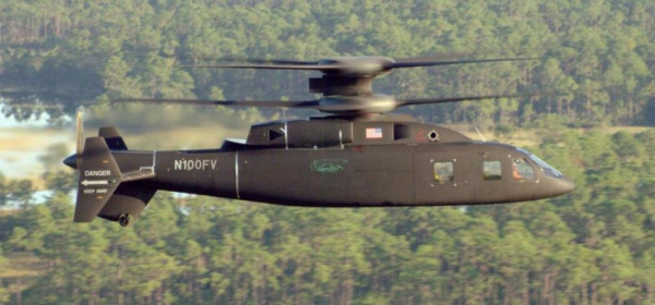 Defiant X helicopter flying side view