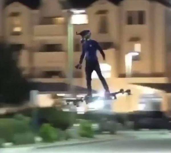 Man flying on hoverboard in the street