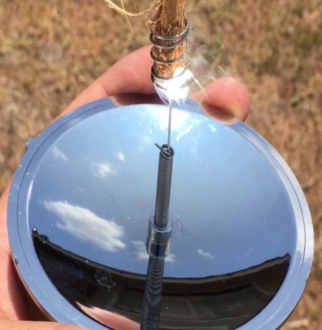 Parabolic mirror solar fire starter/lighter lighting feathered stick