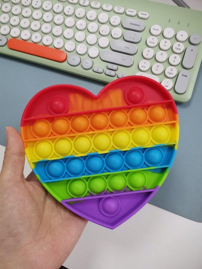 Bubble Popper Fidget Toy - Rainbow bubble popper sensory fidget toy on keyboard