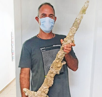 Man holding 900-year-old Crusader sword found in Israel