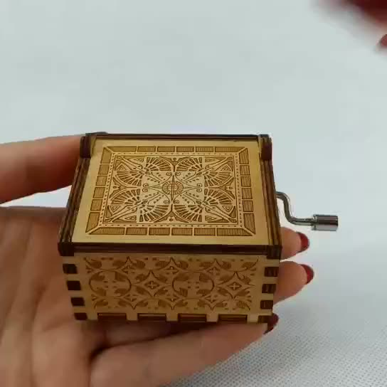 Wooden hand-crank Geek music box
